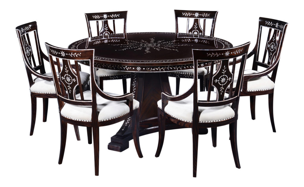 Mother of pearl furniture. Dining set with circular table and six chairs with a mahogany frame and Macassar ebony veneer and mother-of-pearl inlay.